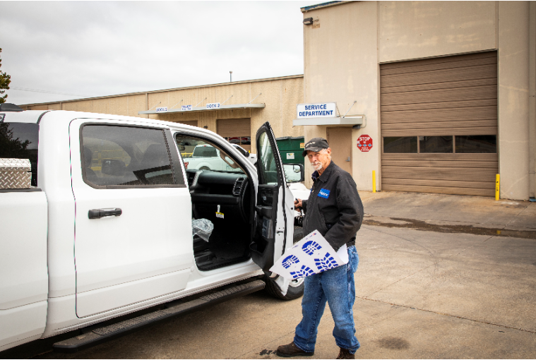 Man getting into a Perfection Truck Parts and Equipment work vehicle